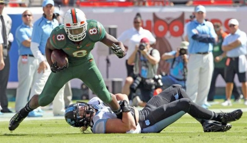 Miami's Duke Johnson runs through North Carolina
