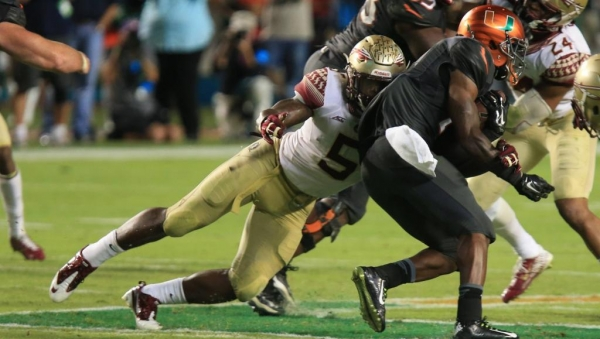 Reggie Northrup Wrestling to Football